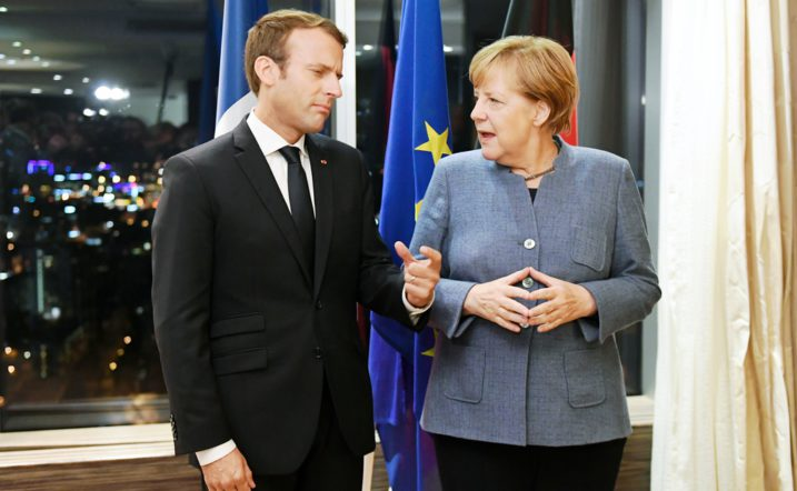 France's President Emmanuel Macron (L) and Germany's Chancellor Angela Merkel meet on the eve of the European Union Digital Summit in Tallinn on September 28, 2017.  European Union leaders meet for an informal dinner ahead of  full summit on Friday. Talks are expected to feature reactions to French President Emmanuel Macron's speech outlining his new vision for Europe, and discussions on digital issues, a priority for host Estonia. / AFP PHOTO / JANEK SKARZYNSKI
